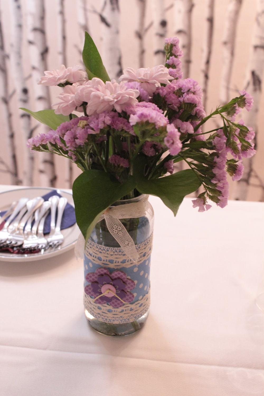 Bote con flores para bautizo